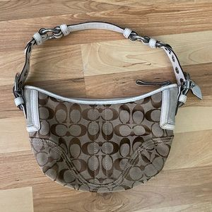 Brown and white coach purse